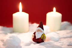Santa Claus with burning candles. On red background Stock Images