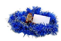 Santa Claus with a business card in tinsel. Father Frost and a New Year's tinsel with cut-away for a congratulation Stock Photography