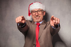 Santa claus business man pointing his fingers Stock Photo