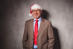 Santa claus business man standing with hands in pockets Stock Photography