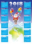 Santa Claus with Calendar 2018. Smiling Santa Claus standing on a top of world globe, New Calendar 2018 in the background Royalty Free Stock Photos