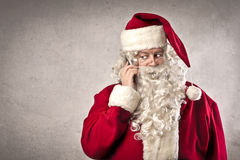Santa Claus Call. Ing with a mobile phone Stock Images