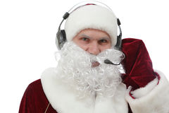 Santa Claus Call Center. Santa Claus with headphones against white background stock images