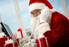Santa Claus calling stock photo