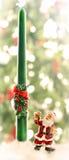 Santa Claus and a candle Royalty Free Stock Photos