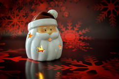 Santa Claus candle christmas. On red background Stock Photography
