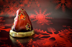Santa Claus candle christmas. On red background Royalty Free Stock Photo