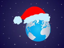 Santa claus cap on earth Stock Photos