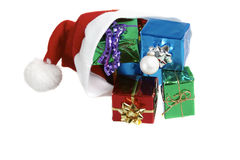 Santa claus cap with gifts Royalty Free Stock Photography