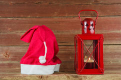 Santa Claus cap and red Christmas lantern Royalty Free Stock Image