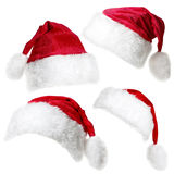 Santa Claus caps isolated on a white background. Set of  red Santa Claus caps isolated on a white background Royalty Free Stock Photography