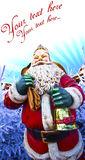 Santa claus card. Statue of santa claus outside holding a bag of gifts and a bell, surrounded of christmas tree with a blue icy sunrise background Royalty Free Stock Photography