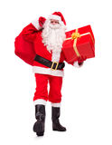 Santa Claus carries Christmas gifts Royalty Free Stock Image