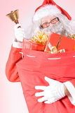 Santa Claus carries gift Stock Image