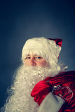 Santa Claus carries gifts. Royalty Free Stock Photo