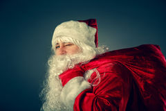 Santa Claus carries gifts. Stock Images