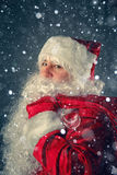 Santa Claus carries gifts. Royalty Free Stock Images