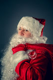 Santa Claus carries gifts. Royalty Free Stock Image