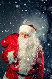 Santa Claus carries gifts. Stock Image