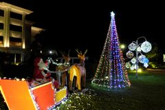 Santa Claus carries gifts in a sleigh drawn by reindeer. New Year decoration. Street festive illumination.  stock photos