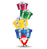 Santa claus carry heavy gift box Royalty Free Stock Photos