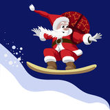 Santa Claus carrying a bag of gifts on a snowboard Royalty Free Stock Photography