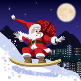 Santa Claus carrying a bag of gifts on a snowboard Stock Photos
