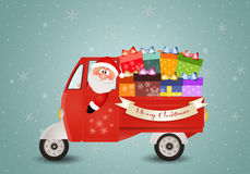Santa Claus carrying Christmas packages Stock Photos