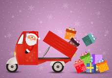 Santa Claus carrying Christmas packages Stock Photography