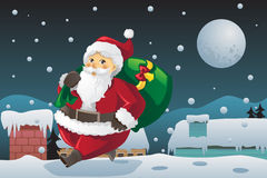 Santa Claus carrying Christmas presents Stock Photography
