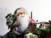 Santa Claus. Carrying a Christmas tree in box of Christmas decorations Royalty Free Stock Photography