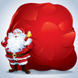 Santa Claus carrying a giant sack Royalty Free Stock Photography