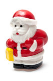 Santa claus carrying a gift Stock Photo
