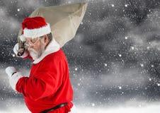 Santa claus carrying gift bag Stock Photography