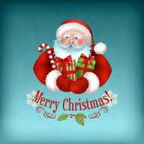 Santa Claus carrying Gifts Stock Images