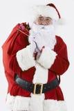 Santa Claus Carrying Sack Filled With gåvor royaltyfri foto