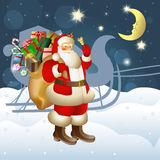 Santa Claus carrying sack full of gifts Stock Photography