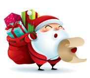 Santa Claus carrying sack full of gifts and holding a list Stock Photography