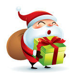 Santa Claus carrying sack and holding a gift Royalty Free Stock Images