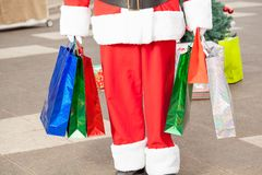 Santa Claus Carrying Shopping Bags Stockfotos