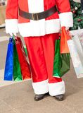 Santa Claus Carrying Shopping Bags Stockfoto