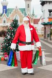 Santa Claus Carrying Shopping Bags In Courtyard Stock Photo