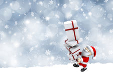 Santa Claus carrying a stack of Christmas gifts Stock Photo