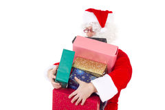 Santa Claus carrying too much gifts Royalty Free Stock Images