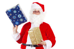 Santa Claus carrying two gifts Stock Images