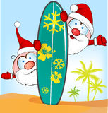 Santa claus cartoon with surfboard Stock Image