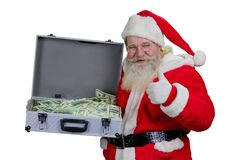 Santa Claus with case of hundred dollars. Portrait of happy Santa Claus holding full suitcase of cash and giving thumb up, isolated on white background Royalty Free Stock Photo