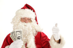Santa Claus with cash Royalty Free Stock Images