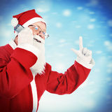 Santa Claus with Cellphone. Vignetting Photo of Cheerful Santa Claus with Cellphone on the Winter Background stock photos