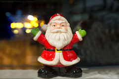 Santa Claus ceramic figure. Christmas decoration on blured background Stock Photo